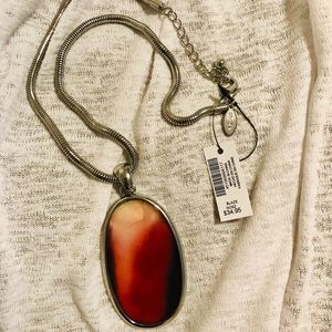 Necklace with orange on silver colored chain
